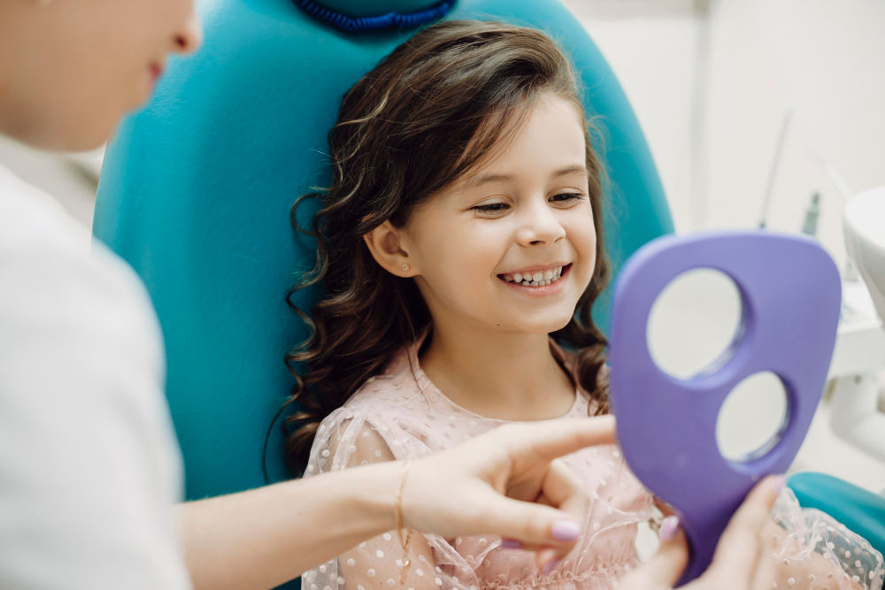 Best Dentist in Manassas | Young patient smiling at mirror